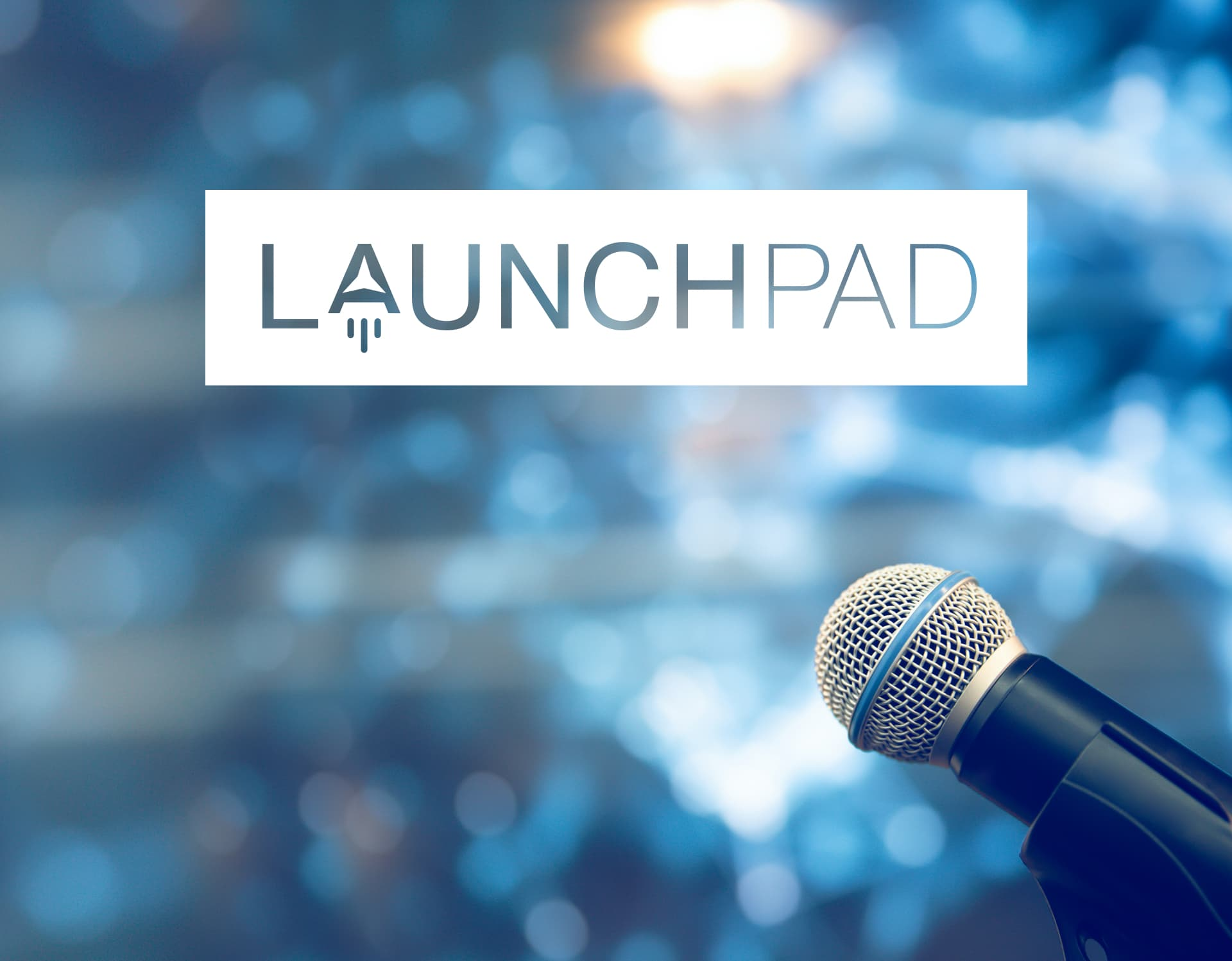 Launchpad logo in front of a crowd.
